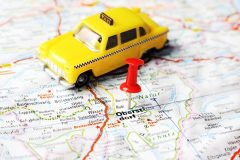 Close up of Oberstdorf , Austria  map with red pin and a taxi   - Travel concept